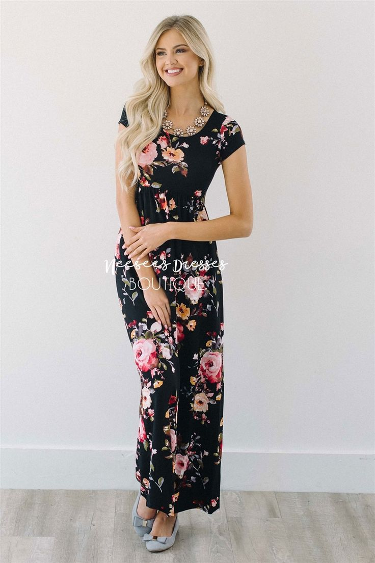 It's no secret that we love comfortable and affordable dresses! This simple maxi can be dressed up or down and you will feel comfortable all day when wearing it. Black maxi dress features a round neckline, short sleeves, and a colorful floral print.