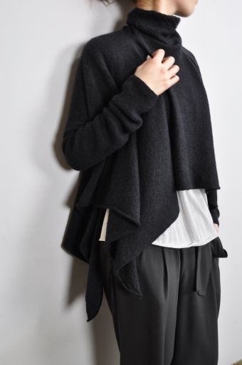 Loose mini-folds (darts? what are the called) on loosely structured pants, and an asymmetrical drapey sweater.