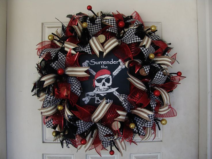"""Deluxe Pirate Skeleton Skull Crossbones Themed Deco Mesh Wreath, Gift, Door, Caribbean, Crossbones, Gasparilla. This is a really cool pirate wreath. If you're looking for more variety, I have many other pirate wreaths up for sale to choose from. It's made and ready to ship! It's approximately 27"""" in diameter. Perfect for the Tampa Florida Gasparilla Pirate Festival, Halloween, Pirate parties, bedroom decor and more! Adorned in black feathers with silver tinsel, lots of coordinating…"""