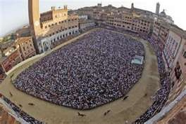 "The Palio, Piazza del Campo- Sienna, Italy. Would love to go back during the summer when this ""neighborhood"" race takes place"
