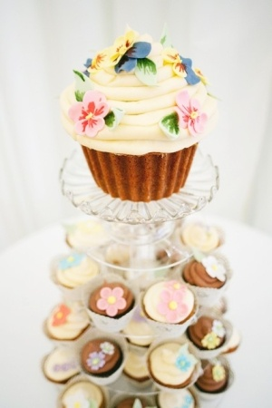 Perhaps even topped off with a giant cupcake so that you can 'cut the cake' ...    bellevuebakery.co.uk