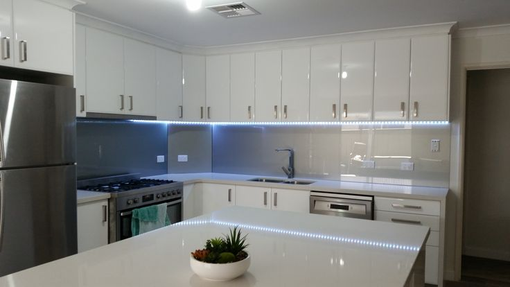 Our metallic glass splashbacks look amazing when they are illuminated. www.asplashofglass.com.au