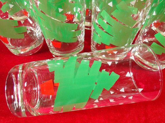Christmas Tree Glasses, Dayton Hudson Christmas Tree Confetti, 8 oz glasses, set of 12 Highball, Water glasses in original box. 6 1/8 tall, 2 7/8 in diameter top, 2 1/2 bottom diameter, holds about 12 OZ comfortably. Bright green brushstroke trees, modern, red bucket stand, white confetti snowflakes. Complete set of one dozen glasses in original box. I dont think they had ever been out of the box until I took them out to photograph. Christmas drinkware, Christmas barware, Holiday party…
