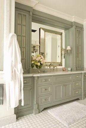 The absolute perfect shade of nuanced greyed green in this lovely master bathroom vanity by Lucas Studio Inc. Love the mirror-on-mirror and the side sconces.