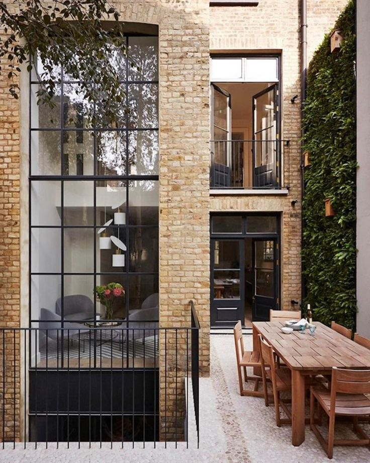 Spectacular multilevel windows! One of the many things to love about his gorgeous home.