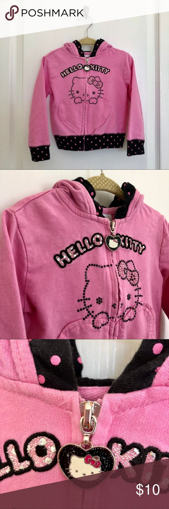 "Hello Kitty, Zip-Up Hoodie, Toddler Girl, 2T Hello Kitty, Doll Pink Zip-Up Hoodie featuring a rhinestone ""Hello Kitty"" design, embroidered ""HELLO KITTY"", patch appliqués on back, black with pink polka dot hems and coordinating fabric as hood lining.  100% Cotton. Machine wash.  Worn with love. Fair condition. Sanrio Shirts & Tops Sweatshirts & Hoodies"
