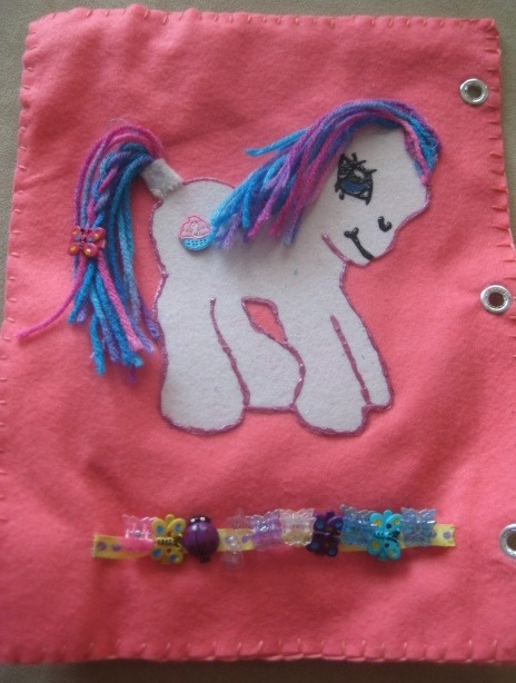 My Little Pony Quiet Book Page. I used yarn for the hair and printed the outline from a coloring page I found online.