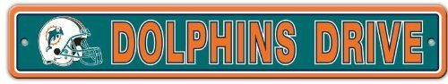 "Miami Dolphins Plastic Street Sign ""Dolphins Drive"" by Fremont Die. $6.99. Sign measures approximately 4"" x 24"". Officially licensed by the National Football League. Pre-drilled holes at sides for easy mounting. Made of durable styrene plastic. Features vibrant team colors and logos. This plastic sign is a great decoration for the rec room or basement bar! Features vibrant team colors and helmet logo, on a sturdy, die-cut plastic sign that will stand up to all kinds of wear and..."