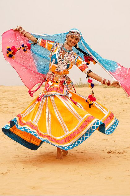 rajastani indian dance... Brightly coloured costume too. Love Love Love brightly colored  traditional indian dresses like this! so pretty