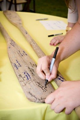 Love this! Have your guests sign wooden paddles! You can hang them in your home and have the forever :)