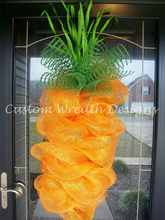 Mesh Ribbon Shaped as a Carrot with green ribbon and green grass at the top of wreath.
