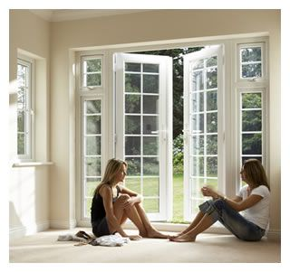French doors with side lights, to replace the sliding glass doors