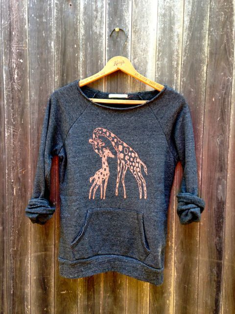 i print an ORANGE mama and baby GIRAFFE onto a Super Soft Sweatshirt that has a wide, raw edge neck. the sweater is soft, comfy and flirty. the