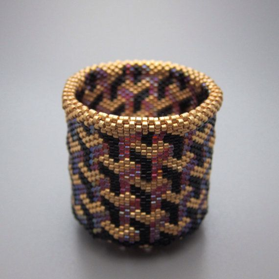 Optical illusion - beaded basket - collectible basket - bead art - seed beads - beadweaving - bead woven basket  This collectible beaded basket is made of hundreds of tiny Japanese delica seed beads woven together with needle and thread. Designing and making these small baskets is a