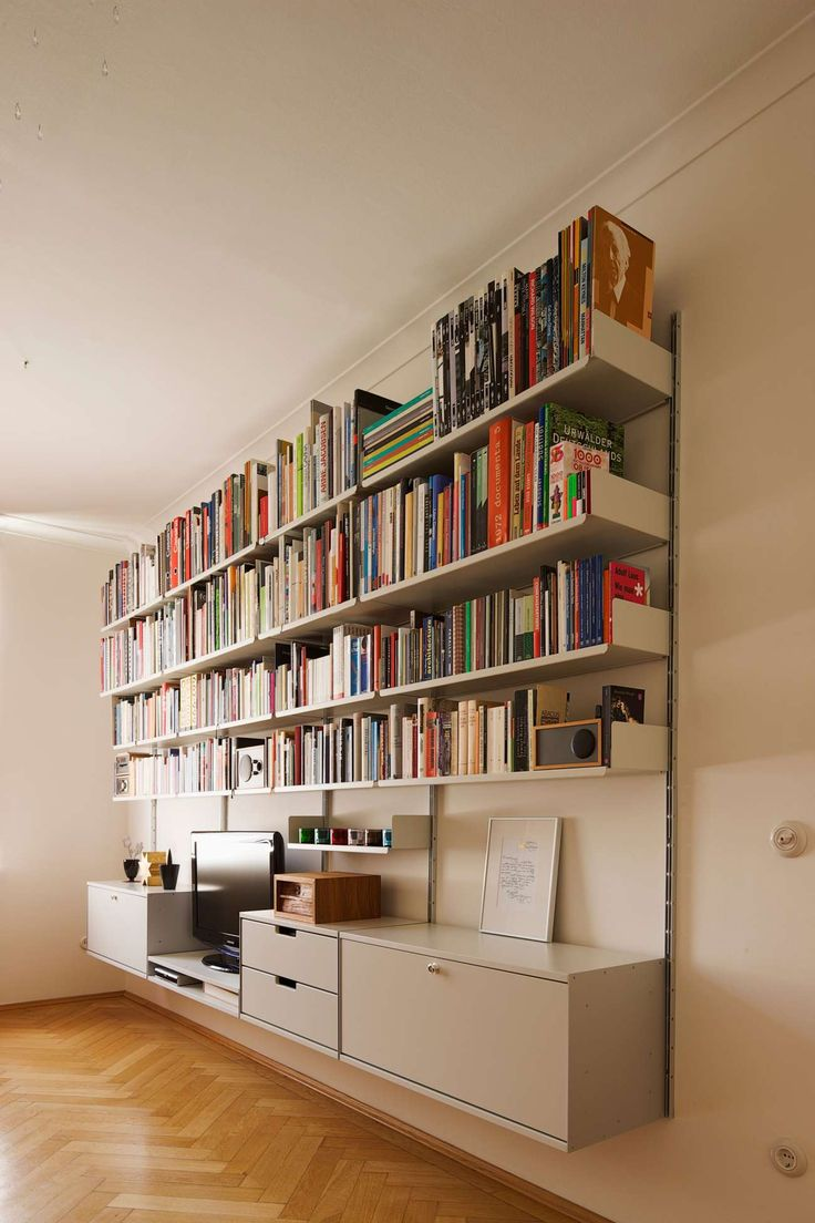 The low double shelf is the natural height for this customer's lower seating; DVD player under the TV. Note shallower shelves at mid height make room feel bigger; deeper shelves above