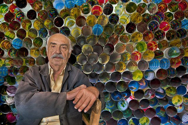 """Tinman"". Fikret the tinman lives in Tarsus. he is the expert of recycling. He makes stovepipe using tins of tomato, cheese and pickle. After I met him, I put colorful tins in a line. I took his photo of happiness, the image was like a honey comb and a colorful rainbow. Location: Turkey, Tarsus. (Photo and caption by Melih Sular/National Geographic Traveler Photo Contest)"