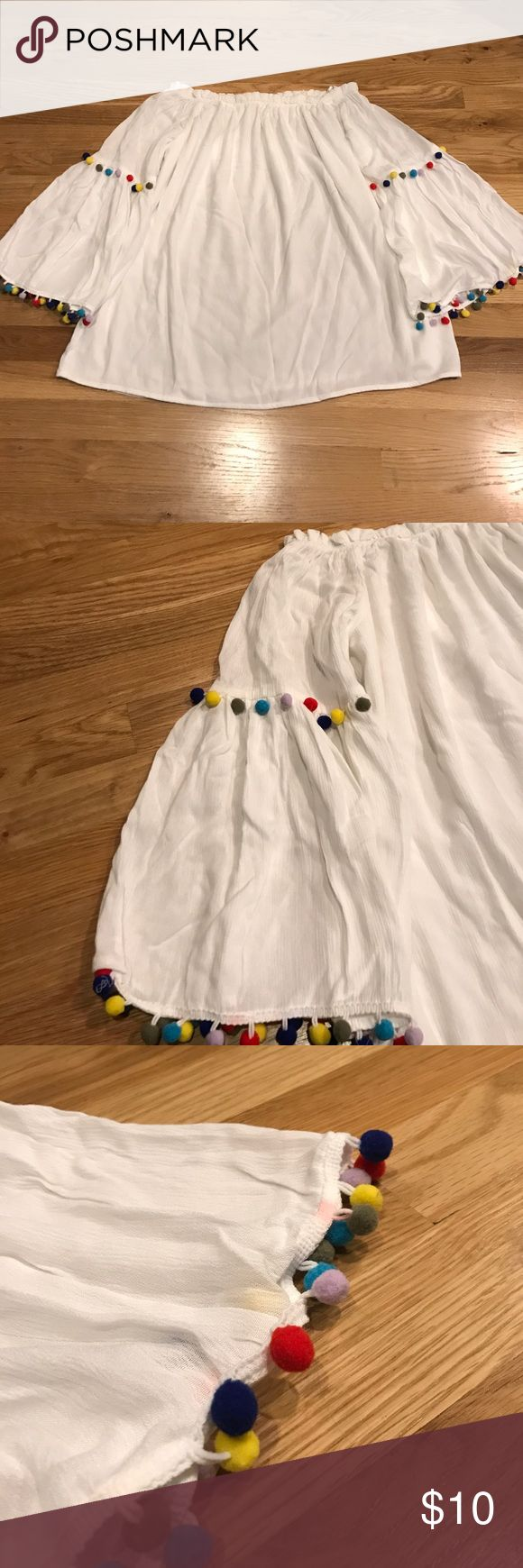 Off the Shoulder Pom Pom Shirt Size small off the shoulder top. Never worn, just didn't fit me! There is a small pink stain on the sleeve shown in the last picture. I received it from the store with that on it. Tops Blouses