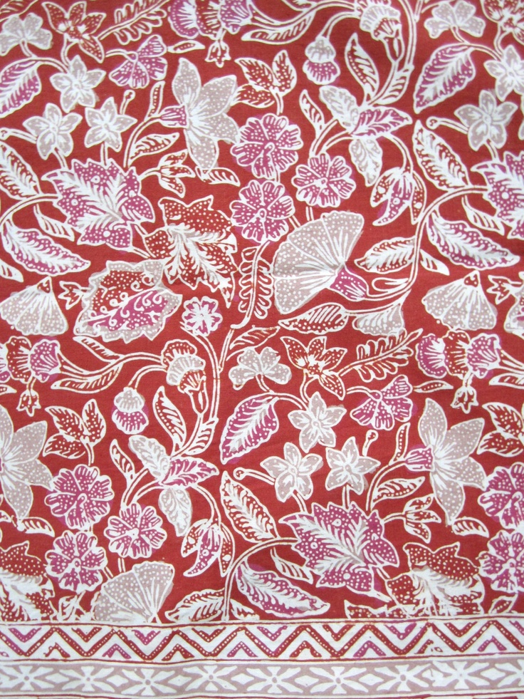 Combinasi #batik from Yogjakarta, Indonesia. Orange background with pink and putty colored flowers. This maker reuses wax and neutralizes water after dying.