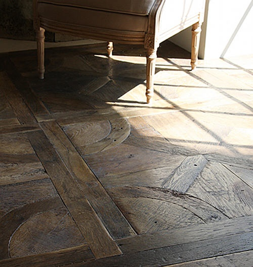 Patterned reclaimed wood floor, interesting use of reclaimed wood. Love it!