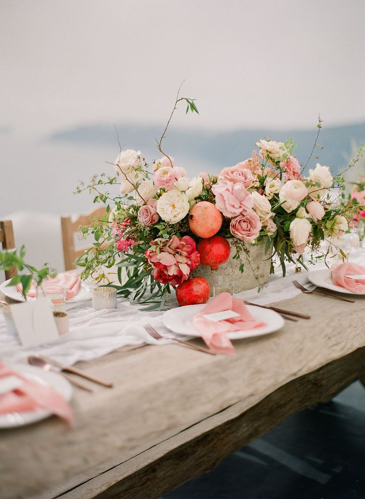 Inspired table arrangement with pastel ivory, peach and blush colours combined with lush corals and reds | Santorini Intimate Destination Weddings