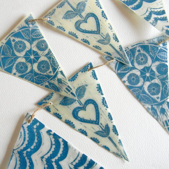 waxed paper lino print bunting by mangle prints