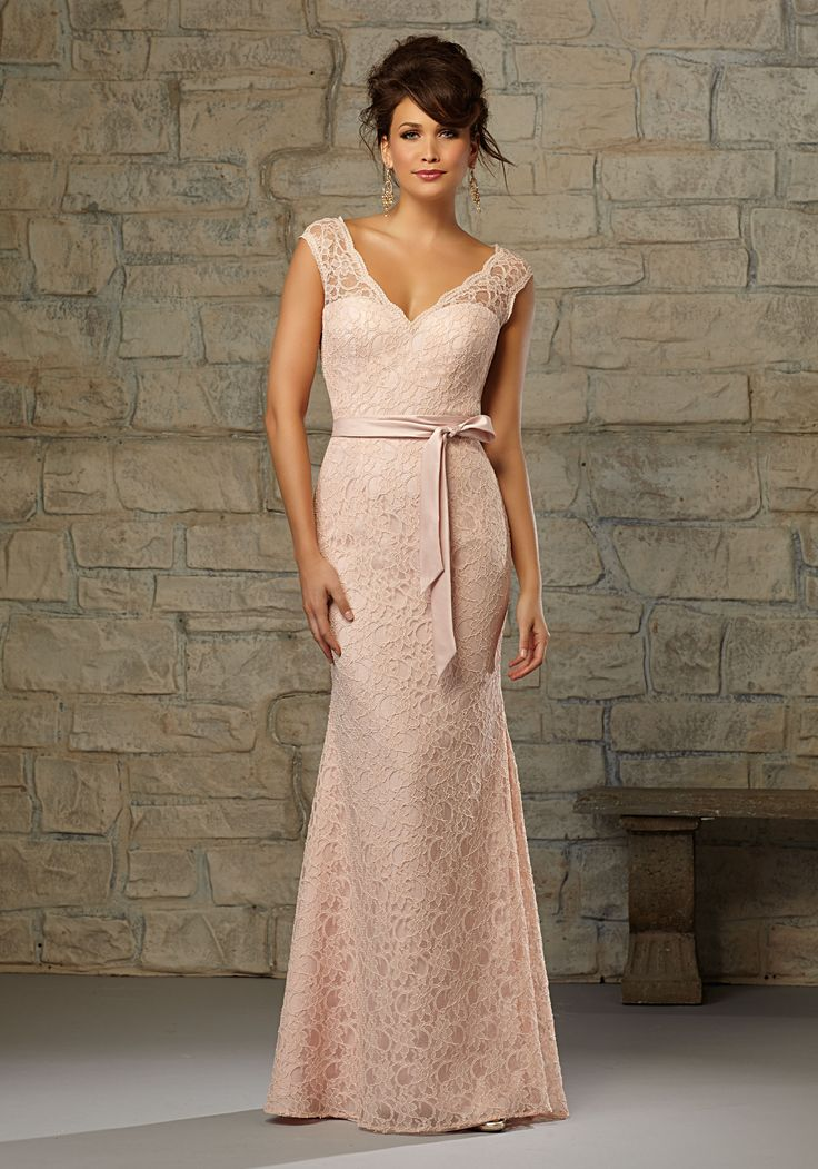 Romantic Lace Bridesmaid Dress with Matching Satin Tie Sash and Cap Sleeves. Designed by Madeline Gardner. Keyhole Zipper Back. Shown in Coral and Blush.