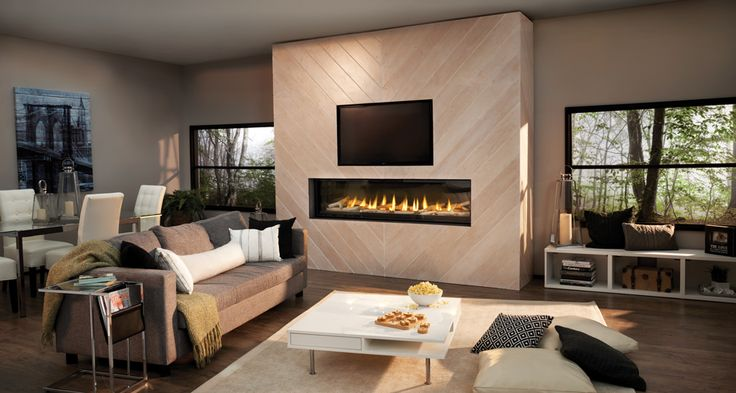 The award-winning glass guard system on the Luxuria™ Gas Fireplace creates two air channels between the firebox and outer glass serving to redirect the radiant heat back into the fireplace. As the heat created by the fireplace rises, it is drawn through micro chimneys, which pulls more cool air into the fireplace. The rising hot air is pulled into an air passage, which distributes the heat through the Dynamic Heat Control™ System outlet.