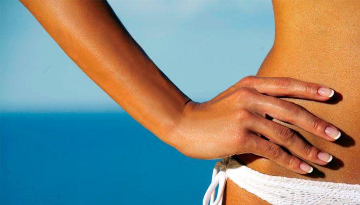 Trucos para quitar las manchas en la piel, cara, manos y brazos