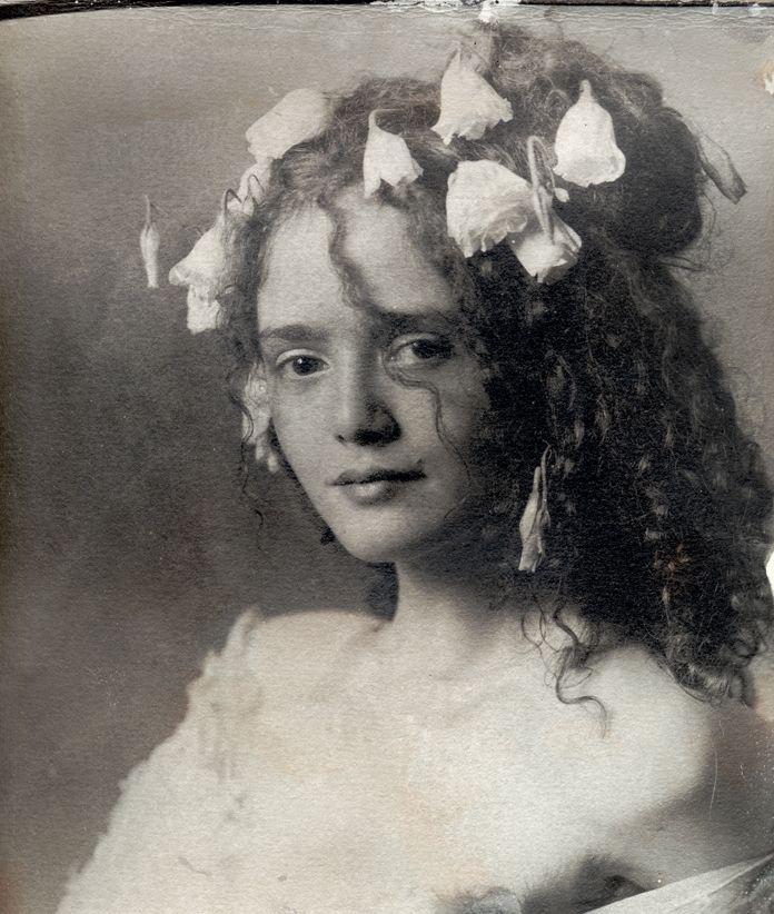Flowers in her hair, who is she? I love her hair, wish mine was like that