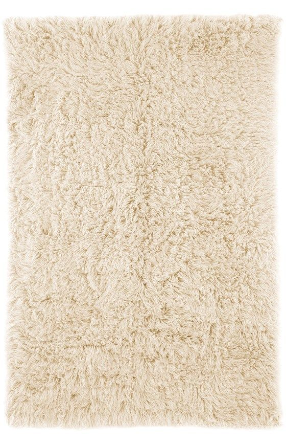 The Rugs USA Standard Shag Greek Flokati Rug is an affordable option for anyone looking to enjoy the luxurious comfort of a Flokati shag rug without spending a fortune. The 2000g Flokati rug is solid colored and versatile enough to fit seamlessly in any design scheme, from traditional to contemporary and everything in between. The shaggy pile is both rich and inviting, while the soft comfort of the 100% wool offers a timeless luxury that is welcome in any home. This rug is available in a…