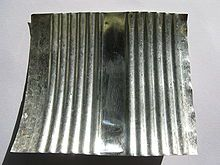 Tin is a chemical element with symbol Sn.This silvery, malleable metal is not easily oxidized in air and is used to coat other metals to prevent corrosion. In 2006, about half of tin produced was used in solder. The rest was divided between tin plating, tin chemicals, brass and bronze, and niche uses