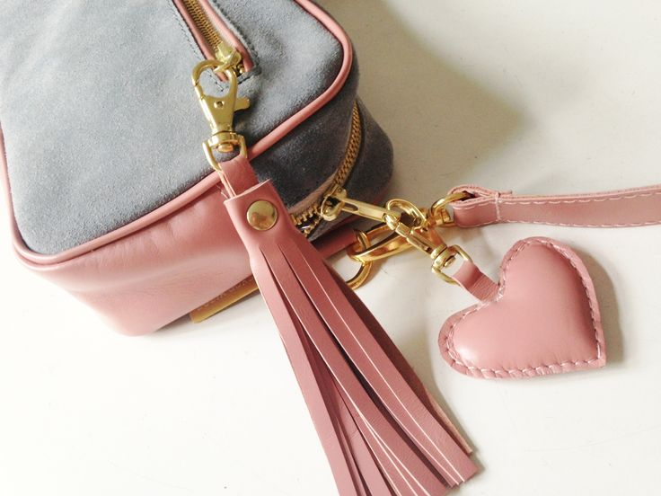 Beautiful bag that can be worn on the shoulder, as a fanny pack or as clutch bag. Decorated with cute pink heart <3