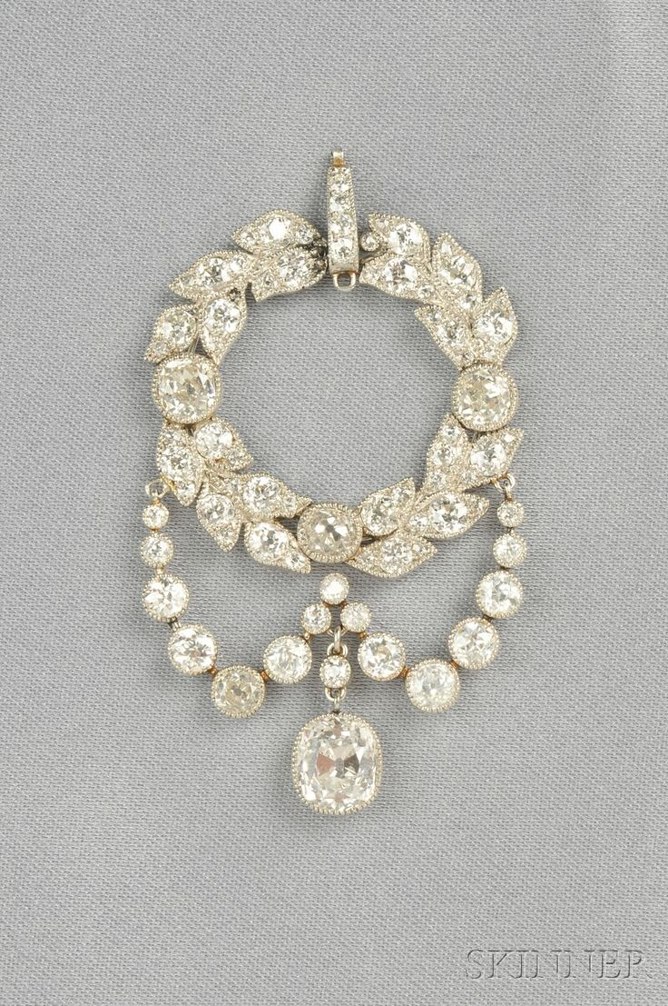 Edwardian Platinum and Diamond Pendant, the old mine-cut diamond drop weighing approx. 1.75 cts., suspended from a garland of old mine-cut diamonds with diamond swags, approx. total wt. 7.09 cts., lg. 2 1/8 in.
