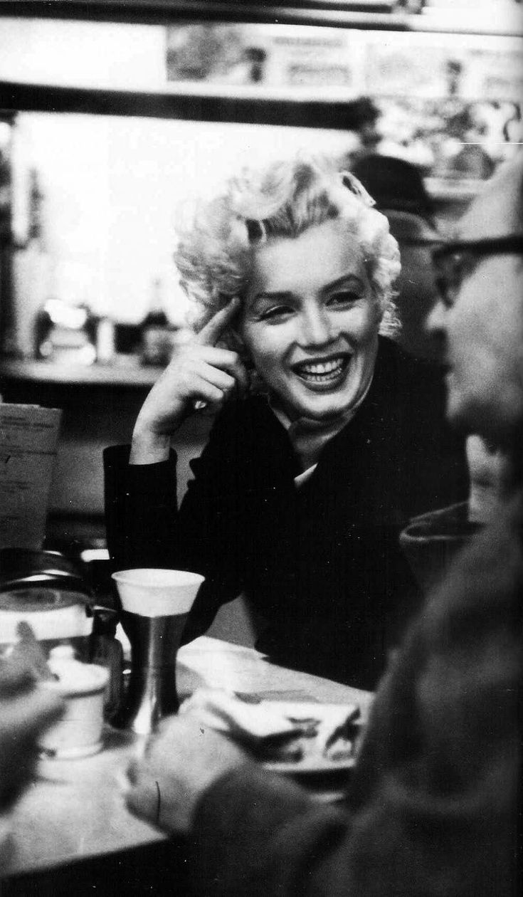 Marilyn and Lee Strasberg in a cafe shortly after attending the Broadway play, A Hatful Of Rain, November 1955.