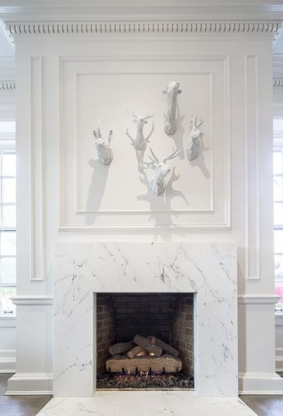 Finally.  The perfect fireplace.  White marble fireplace for a traditional home.