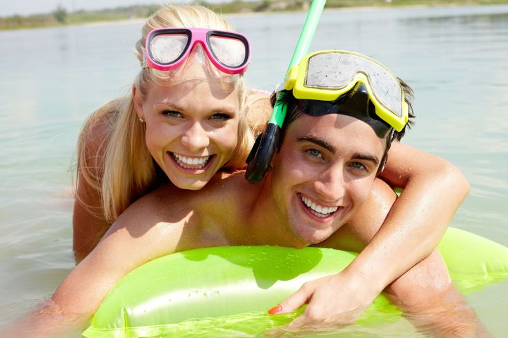 Couple snorkeling during their destination wedding vacation