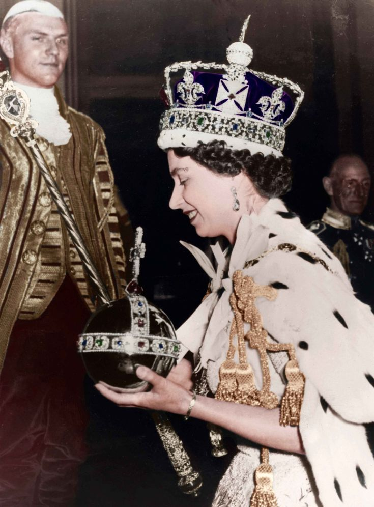 1953 - Queen Elizabeth II returning to Buckingham Palace after her Coronation in Westminster Abbey, London. TownandCountrymag.com