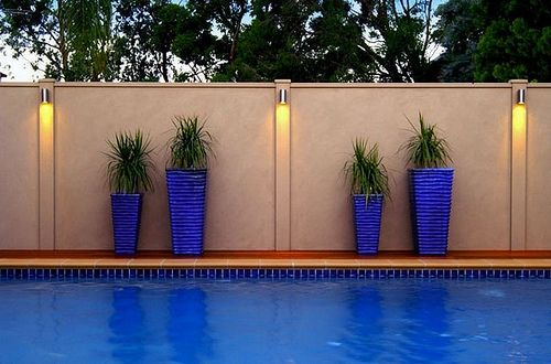 Smart fence swimming pool privacy fence by smart fence lighting and blue accent for cement for Exterior wall designs indian houses