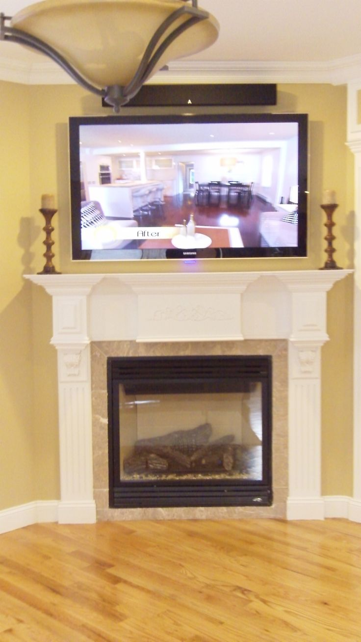 Tv over fireplace with sound bar above home theater for Tv over fireplace
