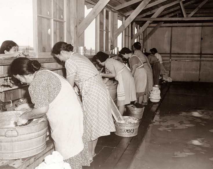 picture is from 1942, and shows women washing clothes in wash tubs with wash boards. The tubs were in a community wash center in Pinedale California.