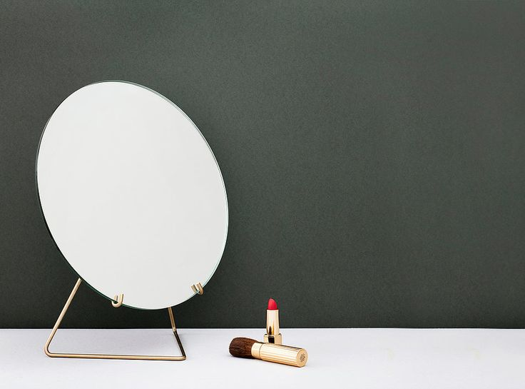 MIRRORis a frame-less free standing mirror held by a lightweight metal wireform.