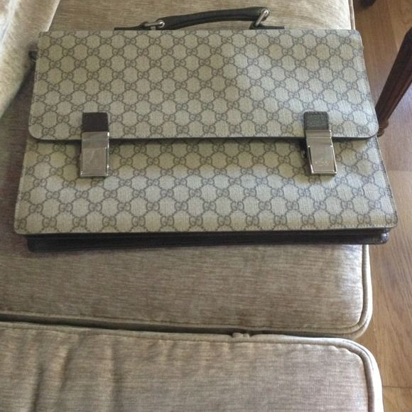 Gucci fabric briefcase This a genuine Gucci fabric briefcase I got it as a gift for my laptop but feel it is too masculine for me. It has only been carried a few times and the time is in very good shape! Retail price is 1000 Gucci Bags