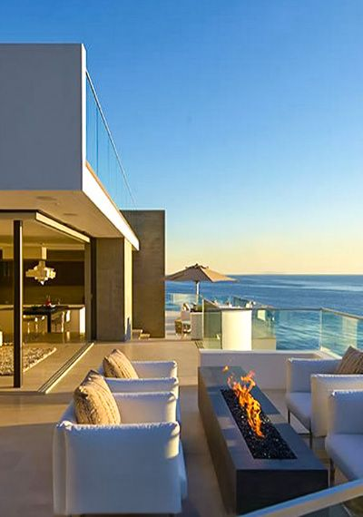 Contemporary Beach House With Balcony Overlooking The Ocean