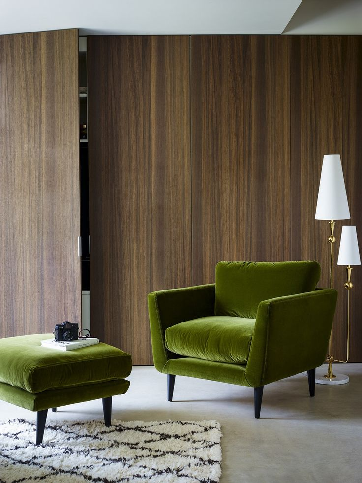For major mid-century style in your home, add a green velvet armchair and footstool to any room.
