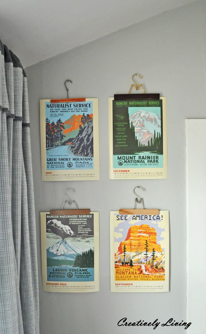 Vintage Travel Posters Hung with Antique Hangers.
