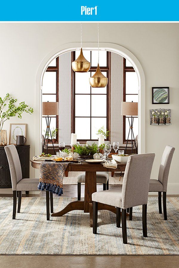 Unwind While You Dine With The Modern Relaxed Style Of Our Heritage Round Extension Dining Table A Round Dining Room Round Dining Room Table Gray Dining Chairs
