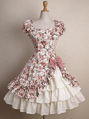 """Ekaterina"" short dress in white with pink flower print, bow, & cascading ruffles from Mary Magdalene."