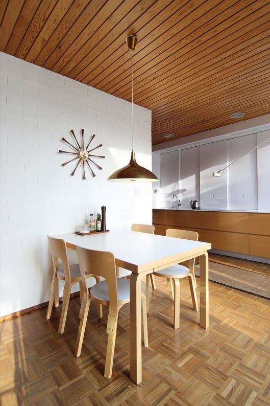 Alvar Aalto dining table (model 82B) and (chairs model 66) designed in 1935. Paavo Tynell pendant light, ca.1950s