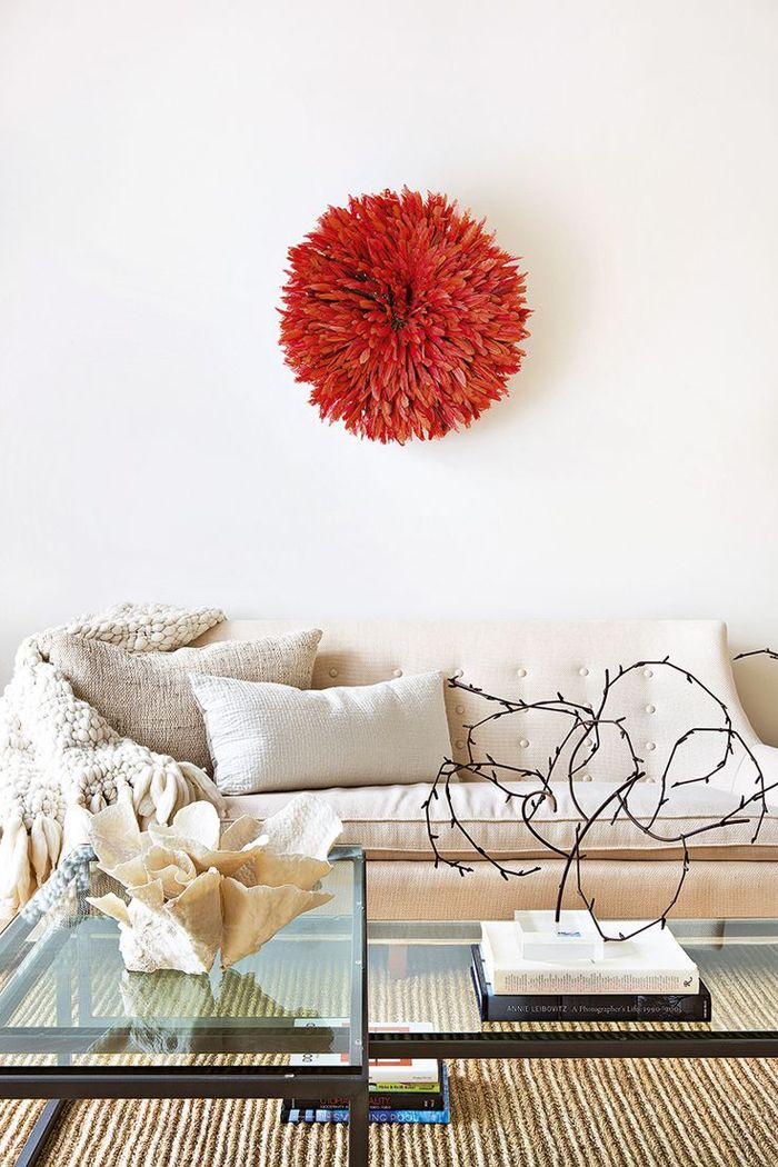 Neutral living room with red juju hat and chunky knit blanket find this pin and more on cameroonian juju hats wall hangings