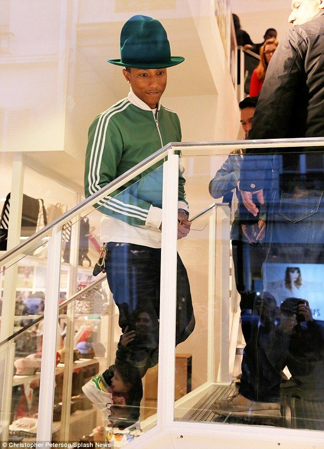 Pharrell Williams creating a stir at the GRAMMYs with his oversized Mountain Hat by British fashion designer Vivienne Westwood.
